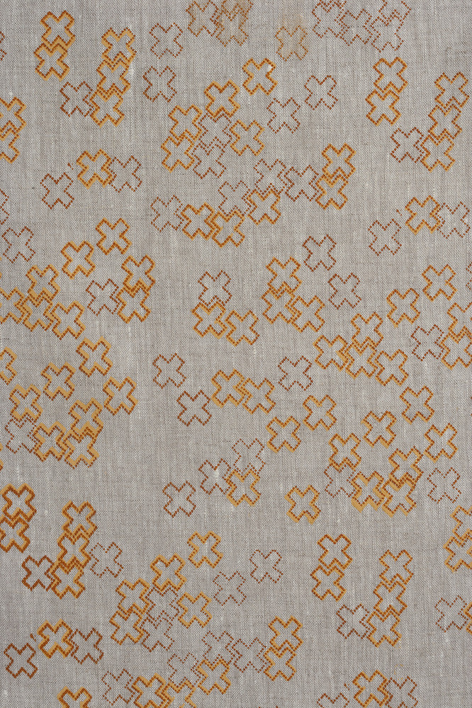 cross dotty mandarin and burnt tangelo linen