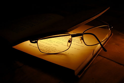 eyeglasses between illuminated pages of an old book_edited.jpg
