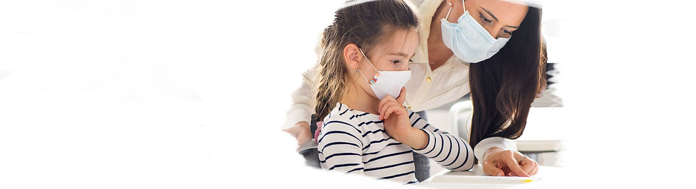Teacher masked helping child.jpg
