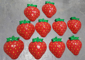 Oversized strawberry props for a slosh routine