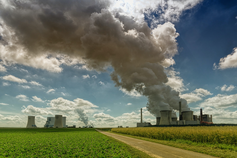 Air pollution is being emitted by large industry.