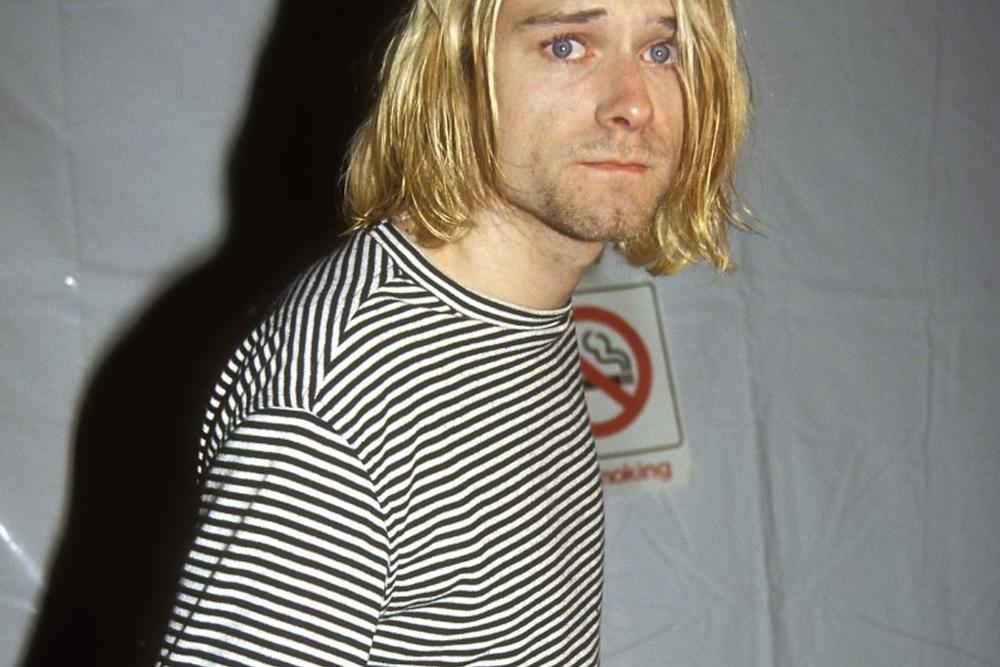 Kurt Cobin wearing a striped sweater