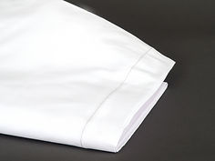 White folded bed sheet