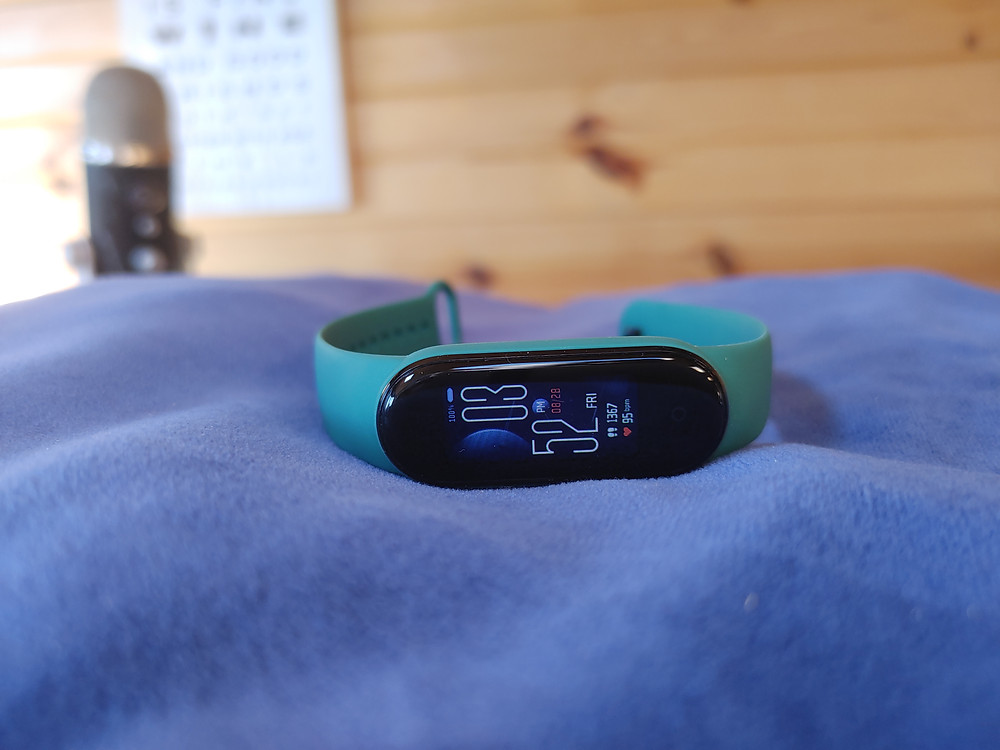Xiaomi Mi Band 5 laying on a pillow