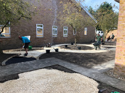August 2019 Paving edging installed, the resin-bound gravel foundations start to go in.
