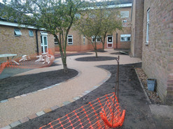 September 2019 Hard landscaping completed and ready to be planted up in October.