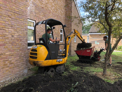 July 2019 We break ground! Work officially starts on the landscaping for the garden. Landscapers are careful not to disturb roots of existing trees that have been incorporated into the design.