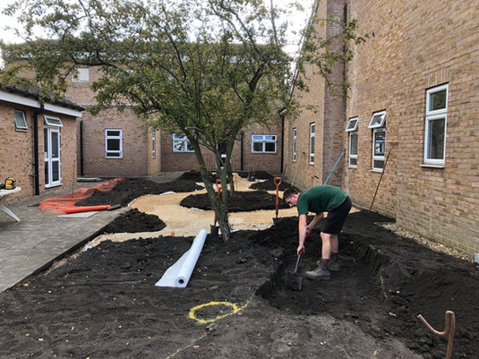 August 2019 Marking out and digging up the paths on the rest of the garden.