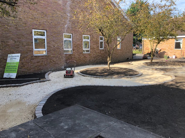 August 2019 Path foundations compacted, cobble edging installed... now for the resin-bound gravel!