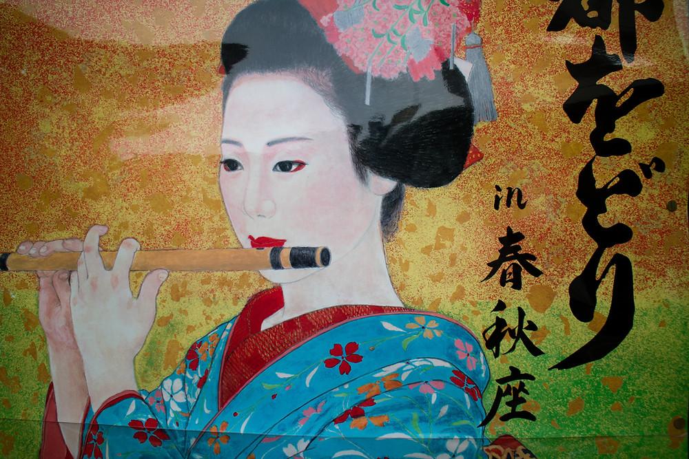 Disegno di una geisha che suona il flauto traverso