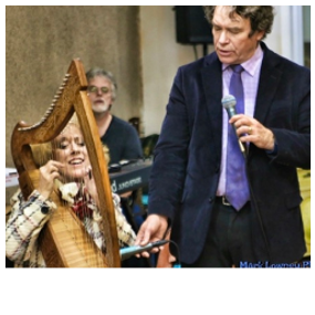 Barry and Shelli Playing Harp.png