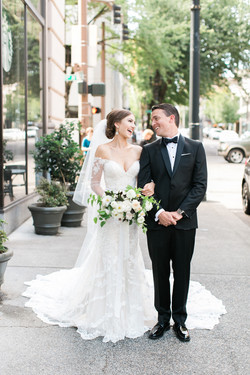 Wedding couple with blush bouquet