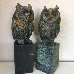 Screech Owl in bronze with a stone base.
