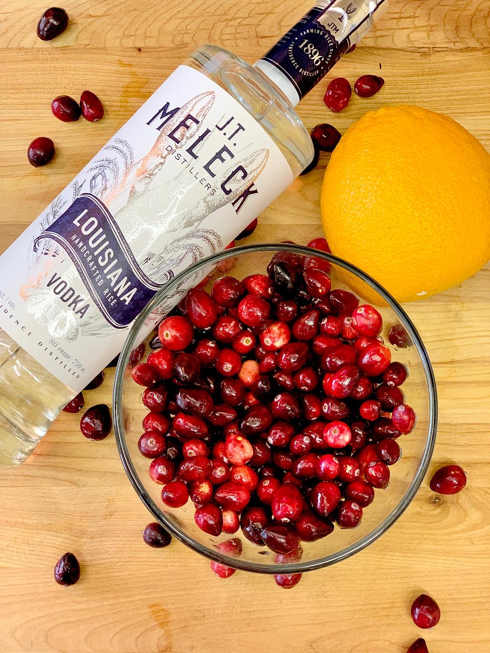 JT Meleck Vodka, cranberry, and orange