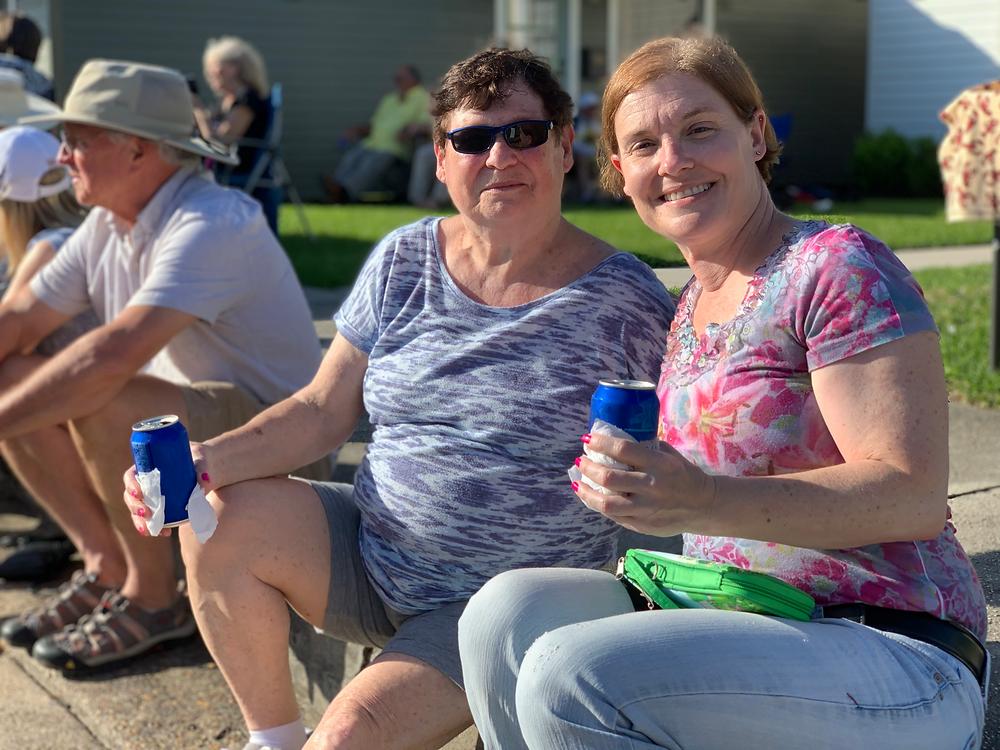 Women enjoying a drink outside at a Louisiana festival