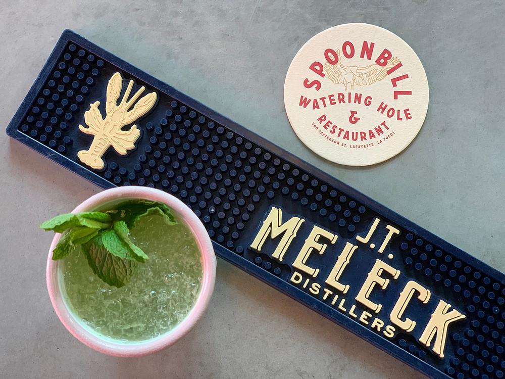 Cocktail below a JT Meleck bar mat and Spoonbill coaster