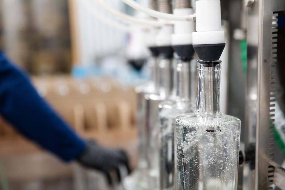 Vodka 101 at a distillery filling bottles with vodka.