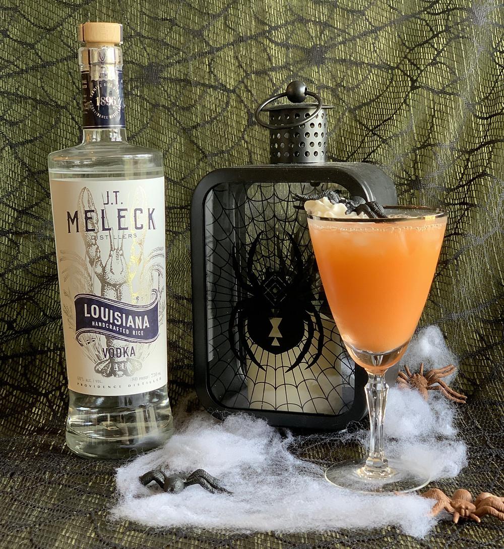 Our Orange Halloween Punch: Boozy Spooky Spider Soda, JT Meleck Vodka, Halloween decorations.