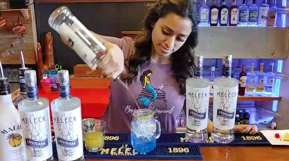 Bartender making the Bayou Mermaid summer cocktail