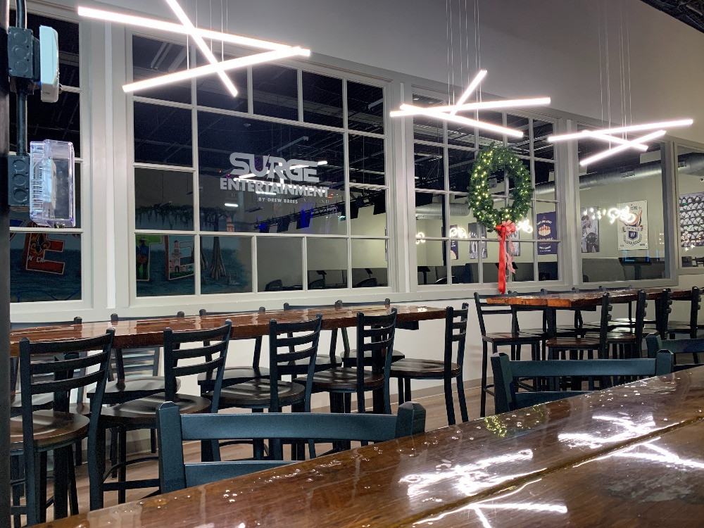 Tables and light fixtures at Surge Entertainment