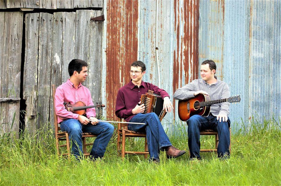 Three guys holding zydeco instruments.