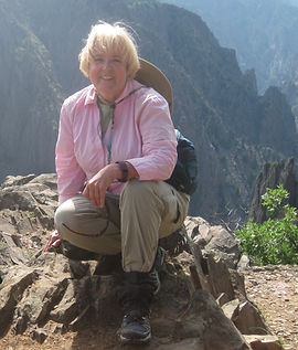 Avid hiker and author Helen T. Doan rests on a rock in Colorado's Black Canyon of the Gunnison National Park