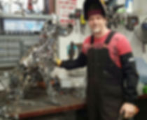 Brian Mock in his shop with a sculpture in progress