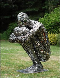 Crouching man, created from recycled materials