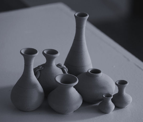 white clay vases on table_edited_edited.