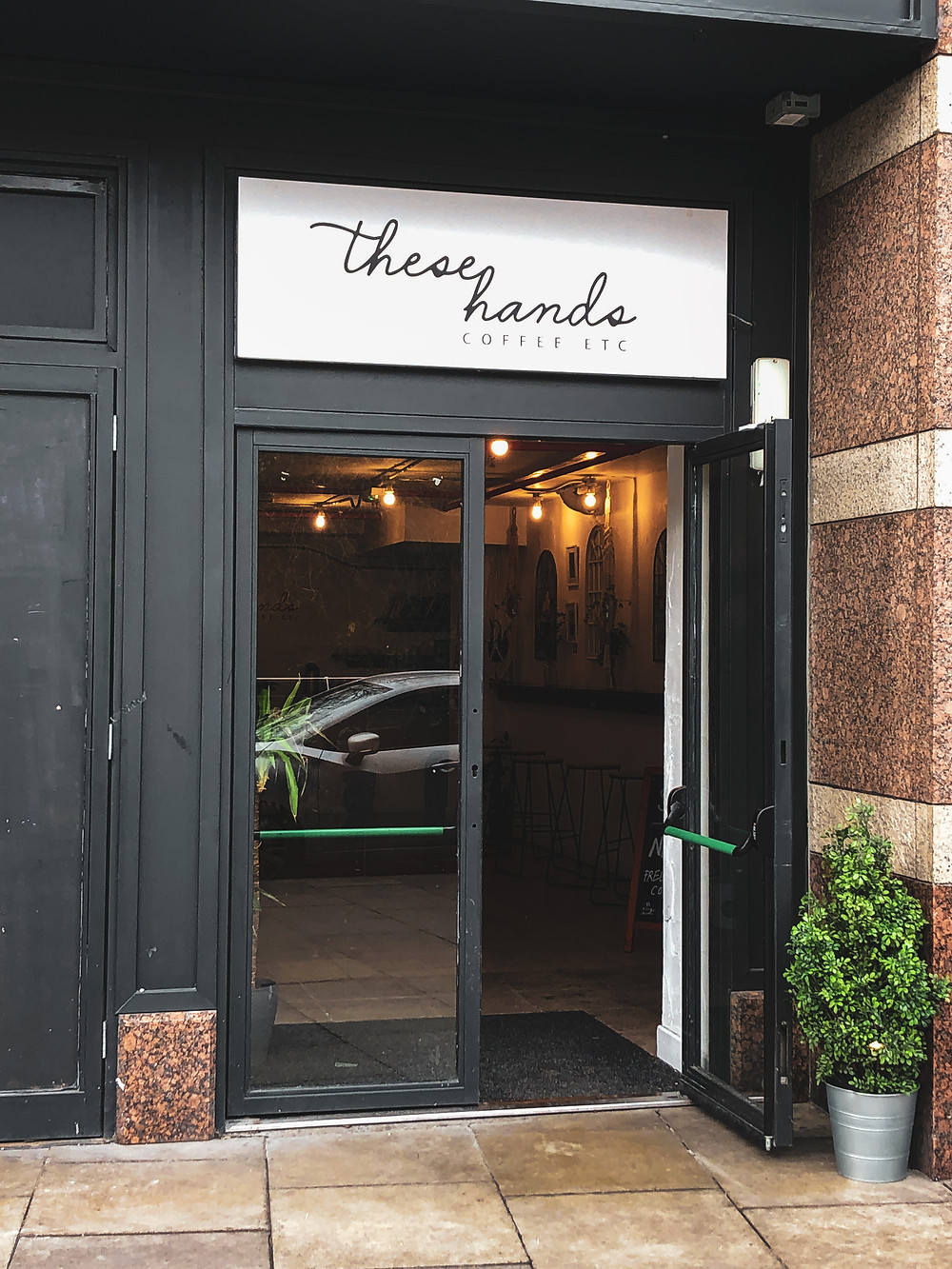 These Hands Coffee entrance
