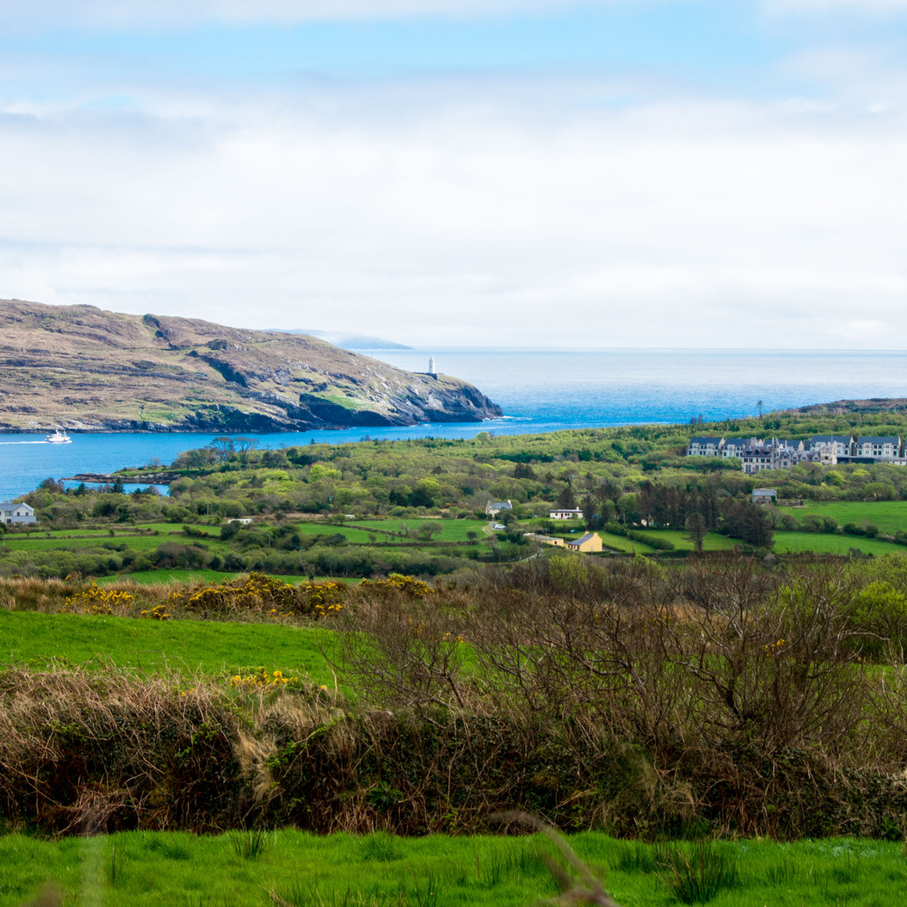 Across the way you can see the Bere Island lighthouse. As the sun peeked out, it lit up the sea with bright blues.