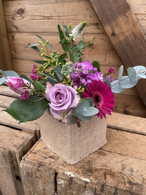 Mothers day - Seasonal flowers in hessian pot