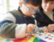 boy scissors rainbow.jpg