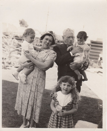 1950 grandparents with grandkids in Los Angeles yard