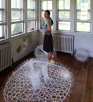 The artist Sui Park with one of her famous Bubble installations.