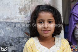 young girl in a small urban area,