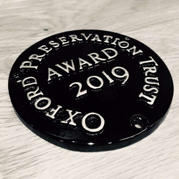 Oxford Preservation Trust plaque for Dora Carr Close