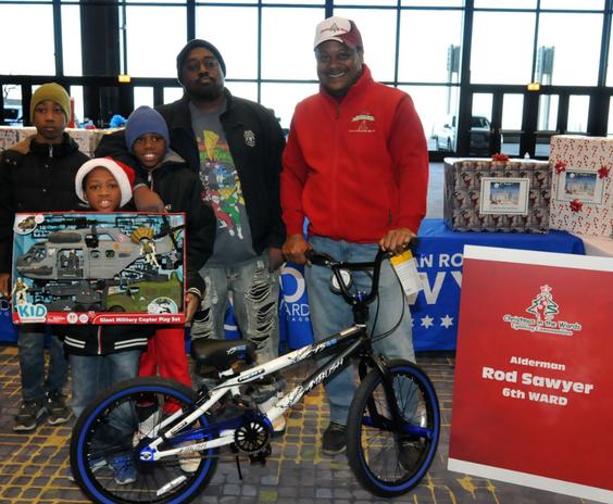 alderman sawyer and kids with bike.PNG
