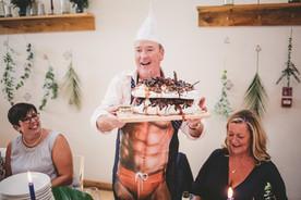 Fun wedding reception photo with cake