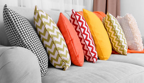 Sofa with colorful pillows in room.jpg