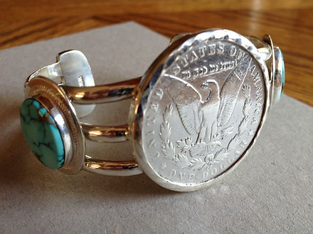 custom sterling turquoise and dollar cuff
