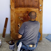 Camarillo house painter working on a door