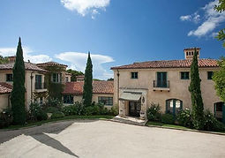 Mediterranean home with color stucco and green trim