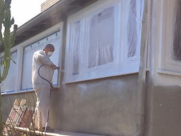 House painter painting window trim