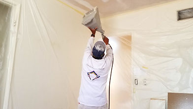 a painter spraying texture on a ceiling in Summerland CA