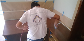 Rainbow Custom Painter in Camarillo spraying lacquer on cabinets