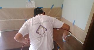 Painter working on cabinet refinishing