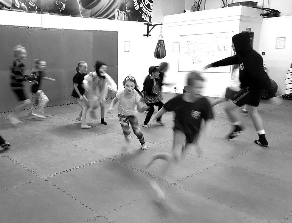 Chldren running around at a martial arts birthday party