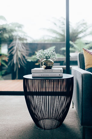 Interior side table setting with vase and book