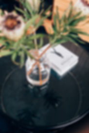 Interior coffe table setting with vase and book